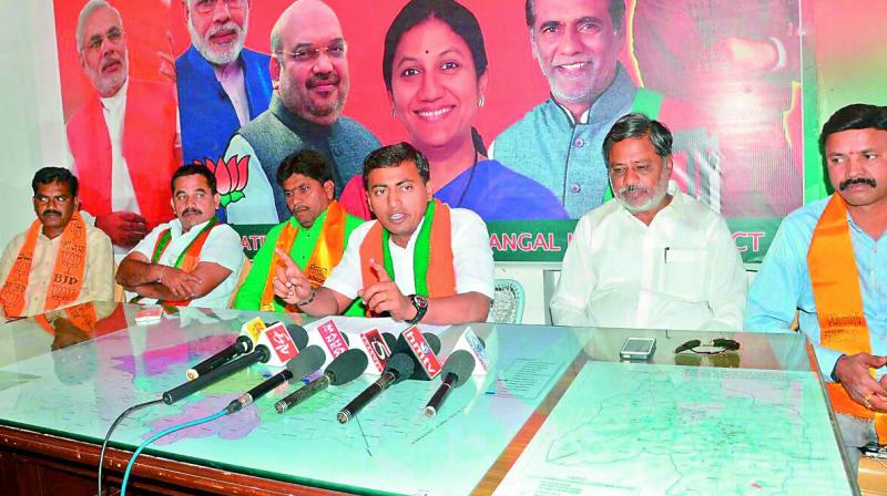 BJP spokesperson A. Rakesh Reddy speaking during a press meet in Warangal on Thursday. (Photo: DC)