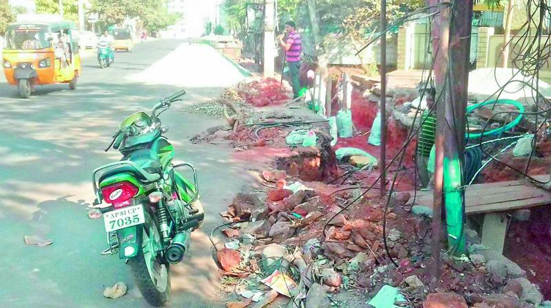 No protective wall is seen at a work site of the GVMC under the Visakhapatnam city limits.