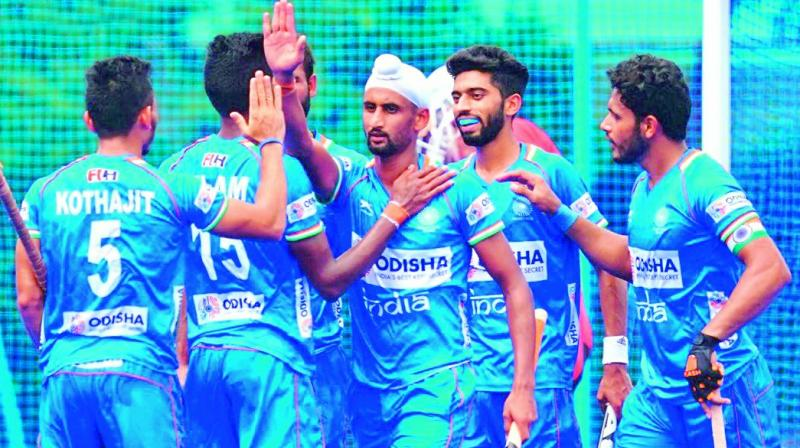 Members of the Indian men's  teams celebrate goals during the finals of the Olympic Test event in Tokyo on Wednesday.