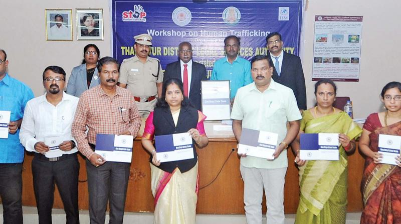 District collector A. Annadurai, and Principal district judge, Thanjavur, V. Sivagnanam a the launch of the 'One stop crisis team' in Thanjavur, on Wednesday. (Photo: DC)