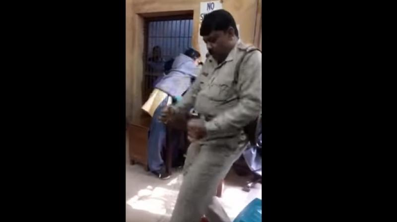 Mondal was celebrating his transfer to the Chittaranjan police station. (Photo: Youtube Screengrab)