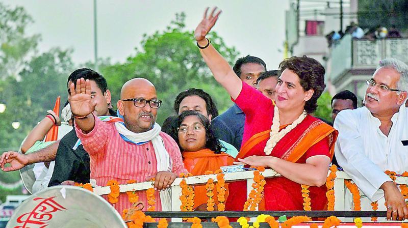 Congress general secretary Priyanka Gandhi Vadra with party candidate Ajay Rai and Chhattisgarh CM Bhupesh Singh Baghel during a roadshow in Varanasi.  (PTI)