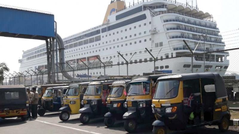 Three-wheelers  wait outside the cruise terminal for tourists from the cruise ship 'Costa NeoRiviera' at Cochin Port Trust in Willingdon Island. (DC)