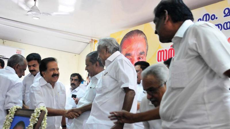 Former chief minister Oommen Chandy greets opposition leader Ramesh Chennithala at a meeting held in memory of  former Kerala Congress (Mani) chairman K. M. Mani  in Thiruvananthapuram on Wednesday. Also seen is party acting chairman P. J. Joseph.  (A.V. MUZAFAR)