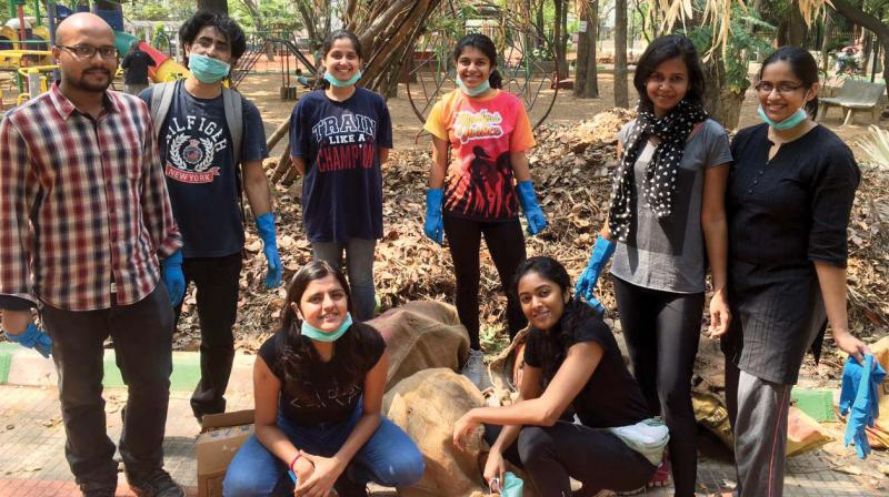 A volunteer group from the city, cleaning up public spaces.