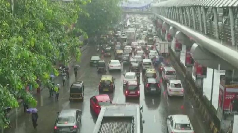 The rains have led to massive traffic jams on Western Express Highway and other parts of the city. (Photo: ANI | Twitter)
