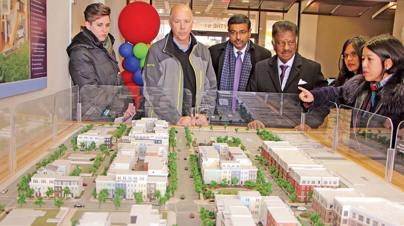 Dy CM O. Panneerselvam observes Washington housing project model.