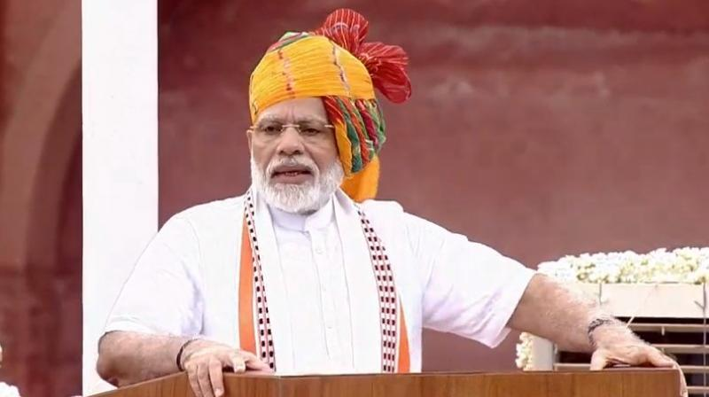 Modi sported a yellow-coloured turban with a dash of green and red along with a long trail that extended till his ankle as he addressed the nation from the ramparts of historic Red Fort on 73rd Independence Day. (Photo: ANI | Twitter)