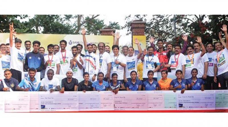 The winners of Kannur beach run at Payyambalam beach in Kannur on Sunday.