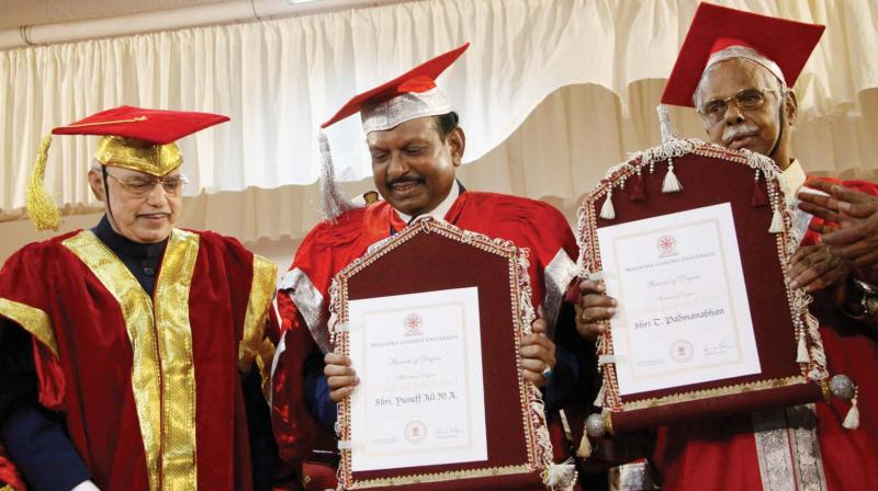 Governor  P.Sathasivam  with  NRI entrepreneur M. A. Yusuff Ali and writer T. Padmanabhan  after  conferring  honorary degree of doctor of letters (D.Litt.) on them at the 7th special convocation organised by the MG University at Athirampuzha in Kottayam on Thursday. (Rajeev Prasad)