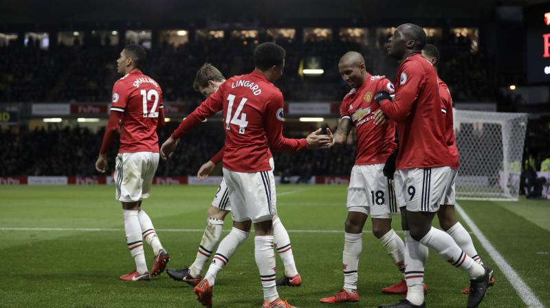 Ashley Young haunts Watford as Man United hold on to win