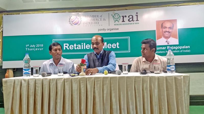 Kumar Rajagopalan, CEO, RAI speaking to presspersons at Thanjavur on Monday. S.P.S.Aruldas,president of CCI, Thanjavur and A.Annamalai, secretary also present.(DC)