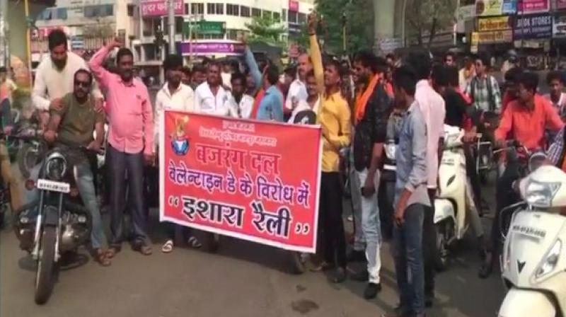 A day ahead of Valentine's Day, posters with messages like 'Say no to Valentine's Day' and 'Love Jihad: Hindu girls beware' were witnessed in Gujarat's Ahmedabad. (Photo: ANI)