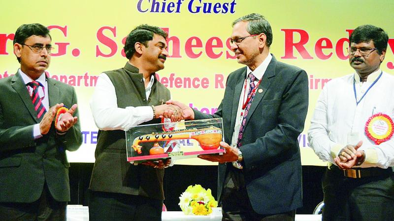 NSTL director Dr O.R. Nandagopan presents a memento to the chairman of the Defence Research and Development Organisation (DRDO) and secretary, Department of Defence Research and Development (DDR&D), Dr G. Satheesh Reddy at the 49th Raising Day Celebrations of NSTL in Visakhapatnam on Saturday. (Photo: DC)