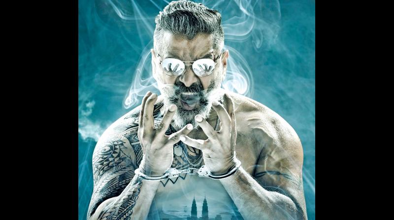The Kadaram Kondan poster shows a heavily tattooed Vikram sporting a funky hairstyle and flashy sunglasses.