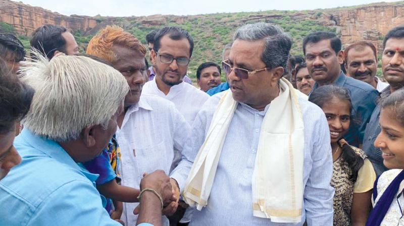 CLP leader Siddaramaiah at one of the villages in Badami taluk a few days ago.