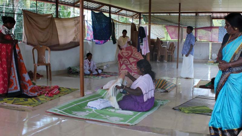 A few family members who took refuge on the rooftop of Homeo clinic of Pandanad panchayath                                           -A file pic