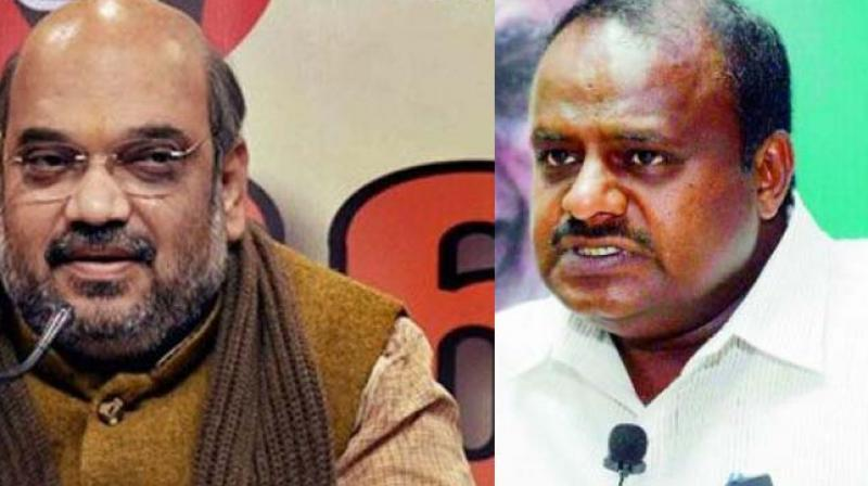 Amit Shah and HD Kumaraswamy