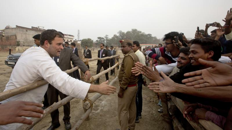 Congress party Vice President Rahul Gandhi greets supporters during an election campaign rally in Raebareli. (Photo: PTI)