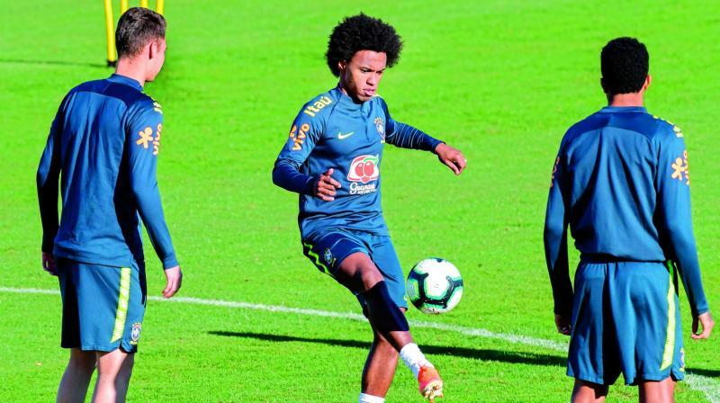 Brazil's Willian controls the ball during a  practice session in Porto Alegre, Brazil. (Photo: AFP)