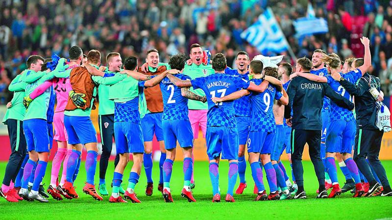 Players of the Croatian football team celebrate after their World Cup 2018 play-off match against Greece in Piraeus, Greece, on Sunday.(Photo: AFP)
