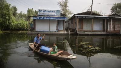 A Kashmiri boatman rows his boat through a closed floating market on the Dal Lake during lockdown to stop the spread of the coronavirus in Srinagar, Indian controlled Kashmir. Indian-controlled Kashmir's economy is yet to recover from a colossal loss a year after New Delhi scrapped the disputed region's autonomous status and divided it into two federally governed territories. (Photo: AP)