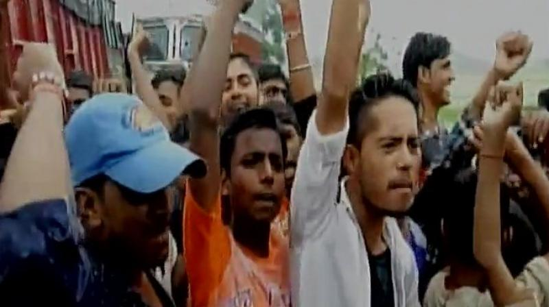 The locals, who beat up the three men, created a ruckus and blocked the NH 84. (Photo: ANI/Twitter)