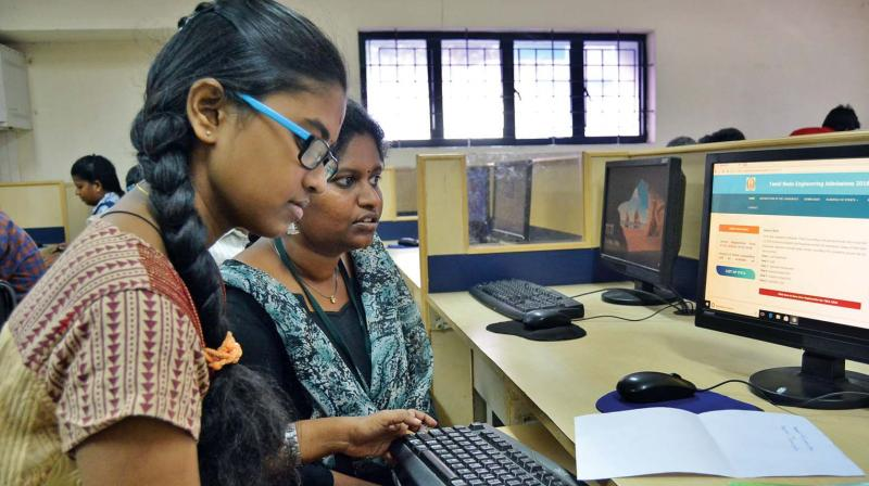 Students registering online application for engineering counselling at Ramanujan Computing Centre in Anna University on Thursday. (Photo: DC)