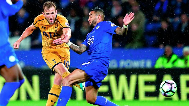 Tottenham Hotspur's Harry Kane (left) shoots past Leicester City's Danny Simpson to score his third goal in their English Premier League match at the King Power Stadium in Leicester on Thursday. Tottenham won 6-1. (Photo: AP)