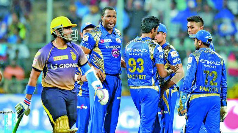 Mumbai Indians' celebrate the wicket of Kolkata Knight Riders batsman Robin Uthappa.
