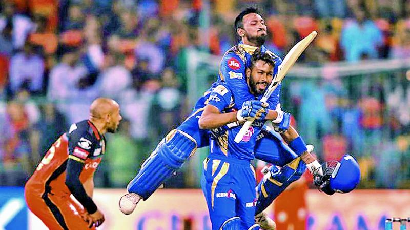 Krunal Pandya celebrates with his brother Hardik Pandya after Mumbai Indians defeated Royal Challengers Bangalore in the group stage of the IPL. (Photo: BCCI)