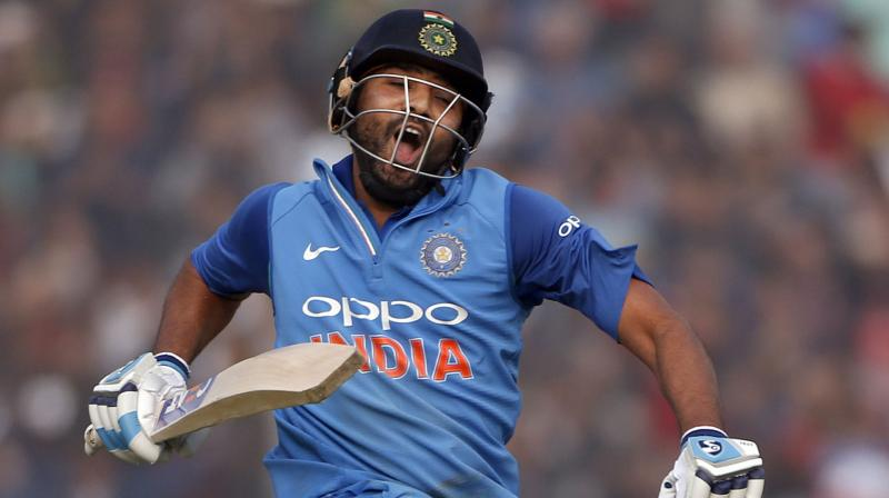 Rohit Sharma, who was leading the Indian side in absence of Virat Kohli, also became the only batsman to score three double tons in ODIs and two against the same opposition. (Photo: AP)