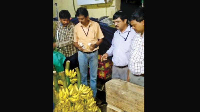 Officials seizes  artificially ripened fruits and chemicals used for ripening at Koyambedu market on Saturday.(Photo: DC)