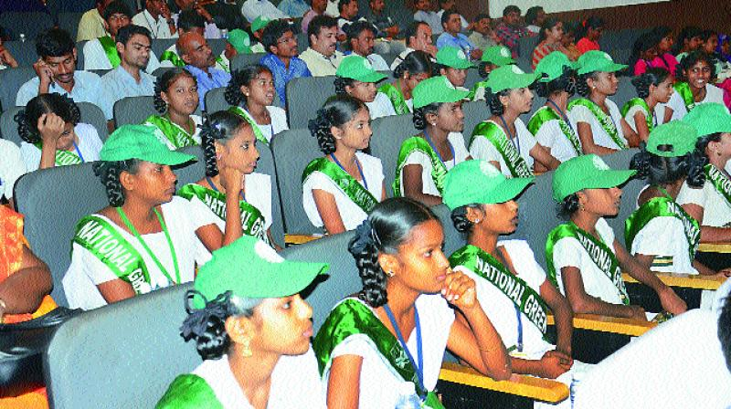 Children from various schools listen to speeches by the dignitaries during a seminar on World Water Day at YVS Murthy Auditorium inside AU Engineering College Campus in Visakhapatnam on Thursday. (Photo: DC)