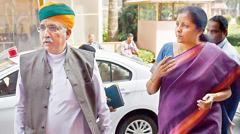 Minister of State for finance Arjun Ram Meghwal with Commerce minister Nirmala Sitharaman during the Budget session of Parliament in New Delhi on Monday (Photo: AP)