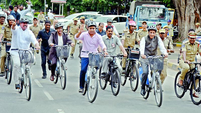 Governor E.S.L. Narasimhan and minister of municipal affairs and urban development K.T. Rama Rao cycle towards Raj Bhavan on Monday.