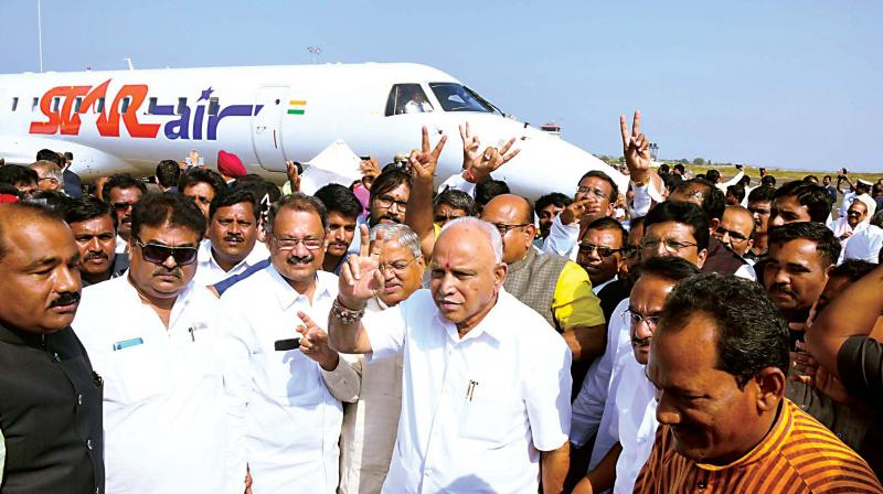 Chief Minister B.S. Yediyurappa along with his cabinet colleagues at Kalaburagi airport on Friday. (Photo: DC)