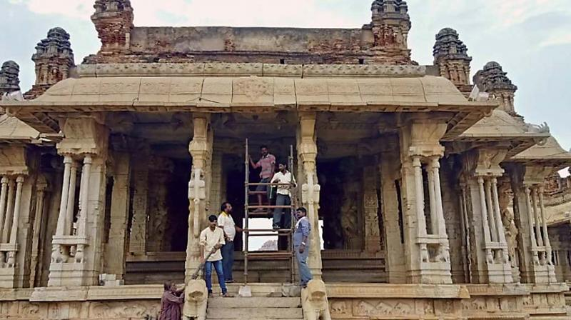 'Sapthaswara Mantapa' with its musical pillars at Hampi being renovated. (Photo: DC)