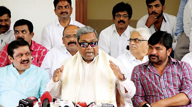 CLP leader Siddaramaiah addresses the media in Bengaluru on Friday. Congress leaders B.Z. Zameer Ahmed Khan and Vinay Kulkarni are seen. (Photo: DC)
