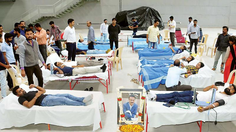 A blood donation camp organised to mark the 60th birth anniversary of Cafe Coffee Day founder Late V.G. Siddhartha Hedge, at ABC campus in Chikmagalur on Friday. (Photo: PTI)