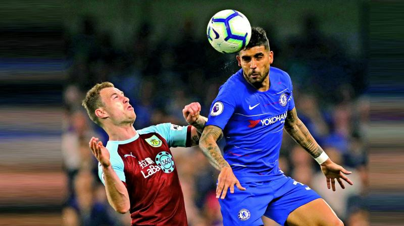 Burnley's Ashley Barnes (left) vies for the ball with Emerson of Chelsea in their Premier League match at Stamford Bridge in London on Monday. (Photo: AP)