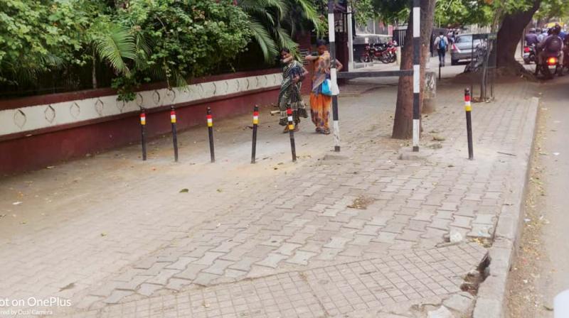 Bollards on the pavement of 100-ft Road in Indiranagar