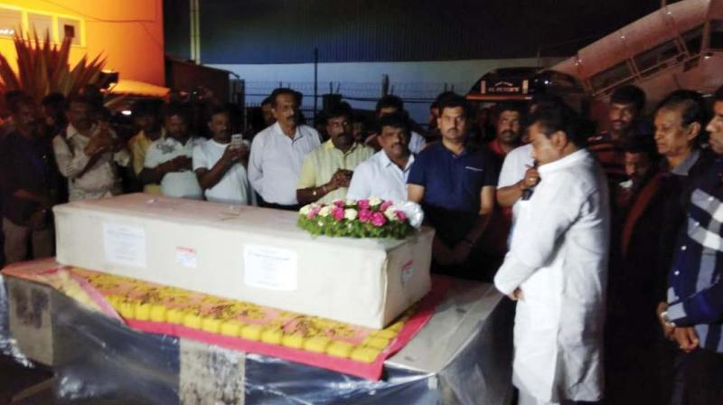 Mortal remains of Nagaraj Shetty and Pala Ramakrishnappa at BIA, after they were flown in from from Colombo on Tuesday night. Home minister  M.B. Patil pays his respects. (Photo: DC)