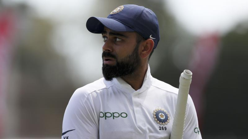 Kohli brought up his half-century in the 55th over of the innings, and he along with Rahane ensured the team does not lose any more wicket before the tea break. (Photo: AP)