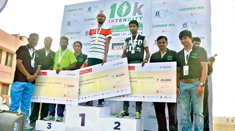 Winners with their cheques received from Olympian V. Bhaskaran.