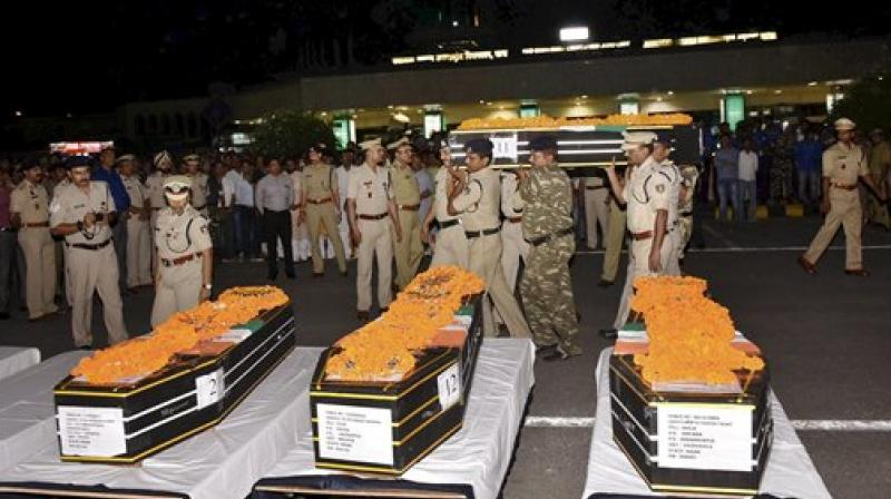 Security persons shouldering the coffin of CRPF jawans after a wreath laying ceremony at Patna airport on Tuesday. 25 CRPF jawans were killed in a Naxal attack in Chhattisgarh's Sukma district on Monday. (Photo: PTI)