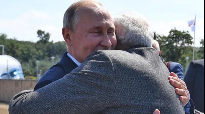 PM Prime Minister Narendra Modi and Russian PM Putin also hugged and shook hands before their departure for Zvezda ship-building complex. (Photo: Facebook)