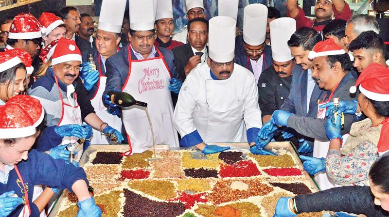 The cake-mixing ceremony held at Hotel Gem Park at Ooty on Thursday. (Photo: DC)