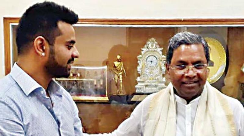 Hassan candidate Prajwal Revanna with Cong leader Siddaramaiah