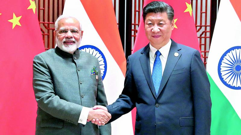 PM Modi receives warm welcome by Indian community in China